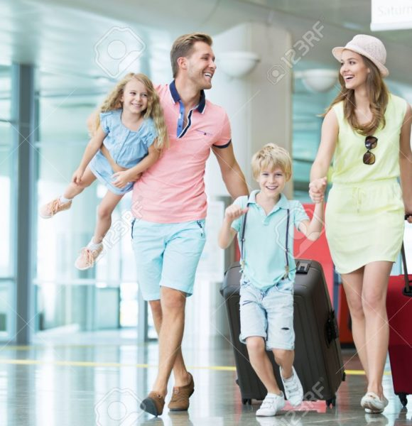 45036274-smiling-family-with-children-at-the-airport